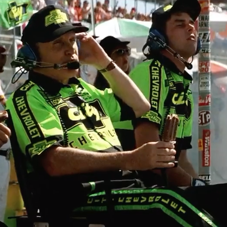Harry Hogge (Robert Duvall) eats an ice cream while refusing a pit stop for Cole Trickle (Tom Cruise) in Days of Thunder (1990)