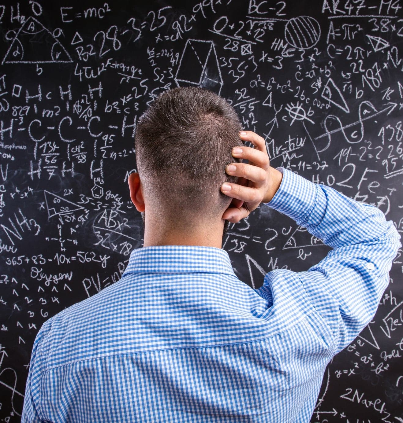 confused man staring at blackboard with complicated equations formulas math Sony Releases 40th Anniversary Retro Walkman That Can't Actually Play Cassettes