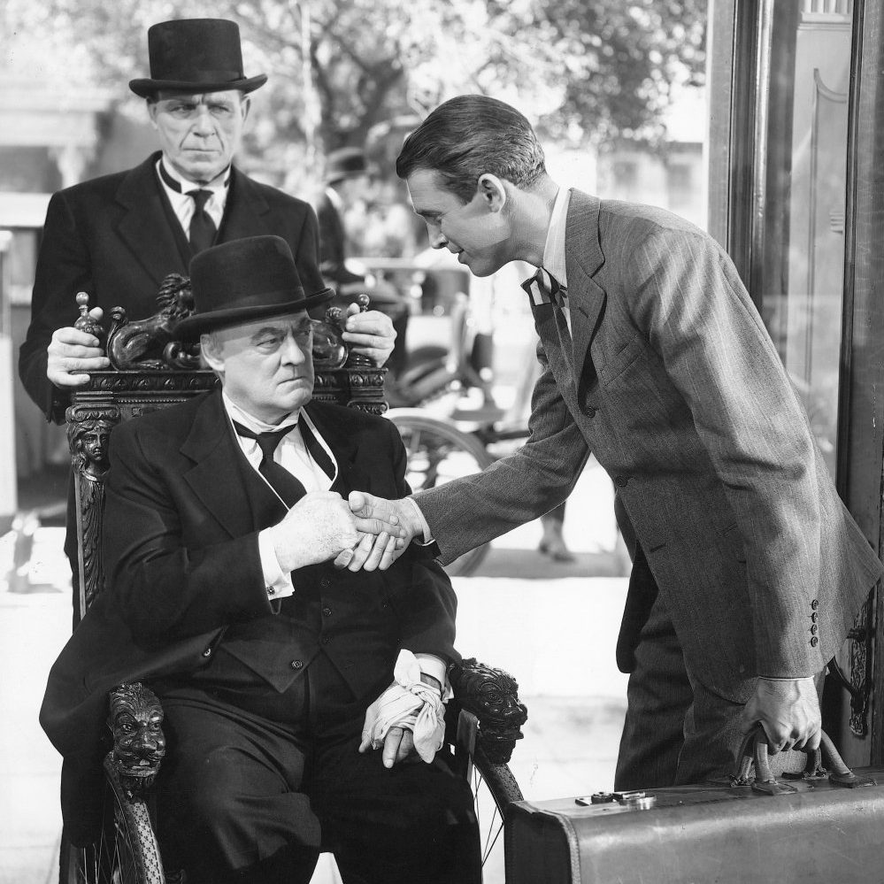 its a wonderful life 1947 006 lionel barrymore on wheelchair and james stewart shake hands 00m d52 e1578482890497 20 'Christmas Movies' That Aren't Actually Christmas Movies At All