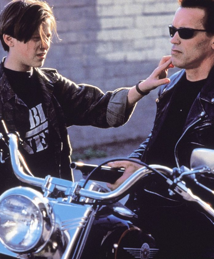 terminator 2 edward furlong arnold schwarzengger e1580991171742 Put That Cookie Down, NOW, And Read These 20 Facts About Jingle All The Way
