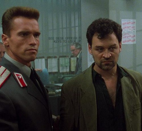 MV5BNjBiMGQ3NmMtOTJjMS00YjllLTg0ODMtZjI1Njc0OWMyMjM4XkEyXkFqcGdeQXVyMTMzNzQ3NA@@. V1 e1621604662292 20 Iron-fisted Facts About Arnold Schwarzenegger and James Belushi's Red Heat