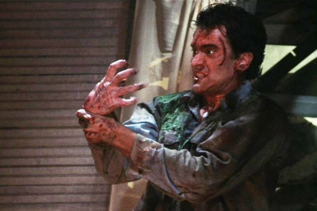 evil dead 2 hand e1633429276120 These Are The Weirdest Horror Movie Franchise Instalments Of All Time