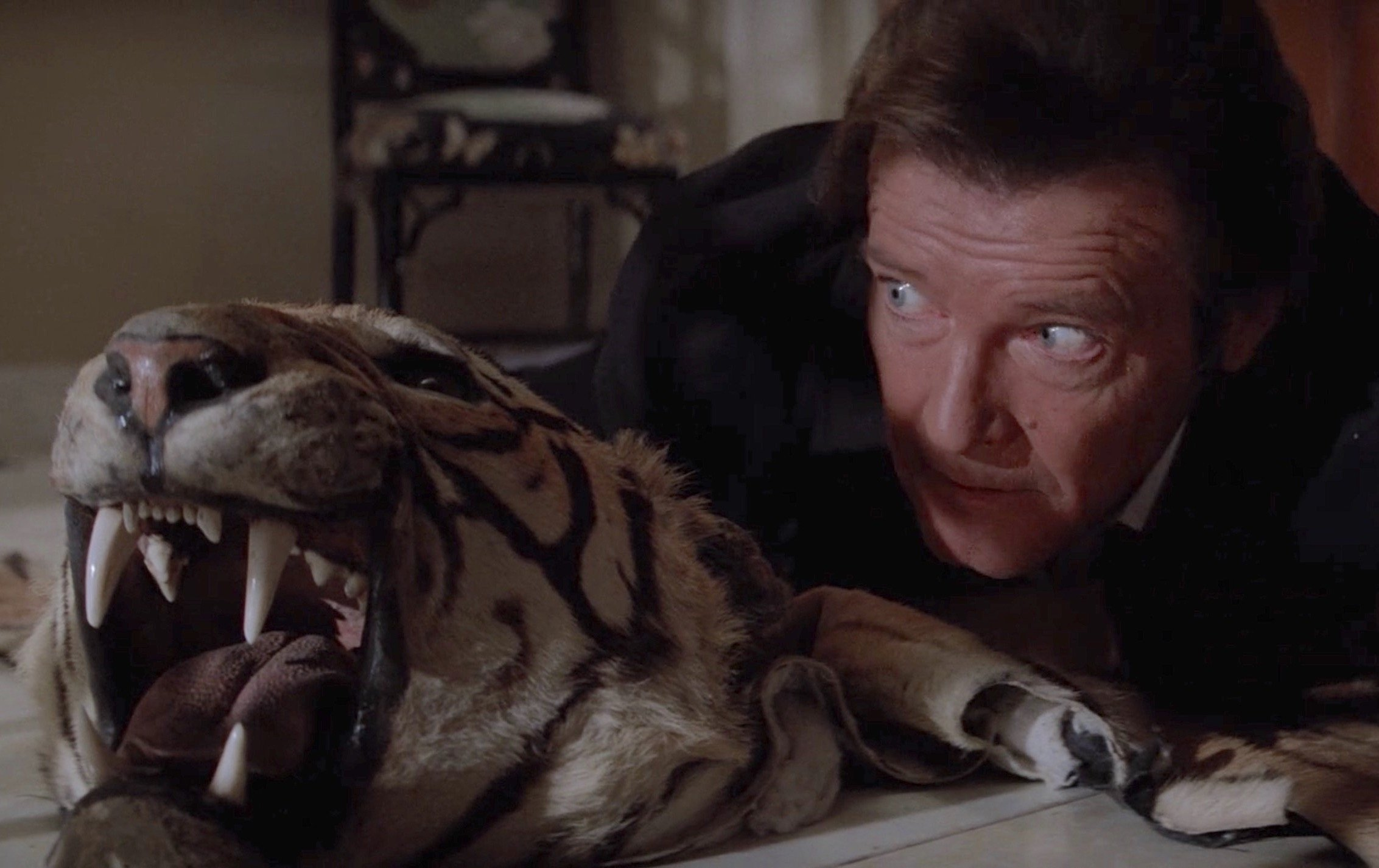 octopussy11 bg tiger 20 Classic James Bond Moments That Have Aged Terribly