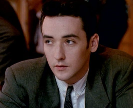 The Grifters John Cusack Armani suit top cap e1616511695284 10 Things You Probably Didn't Know About The Grifters