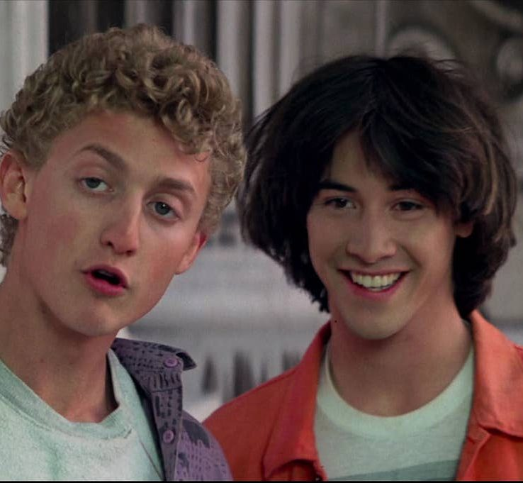 bill and ted socrates smile e1616579532159 25 Totally Non-Heinous Facts About Bill & Ted's Excellent Adventure!