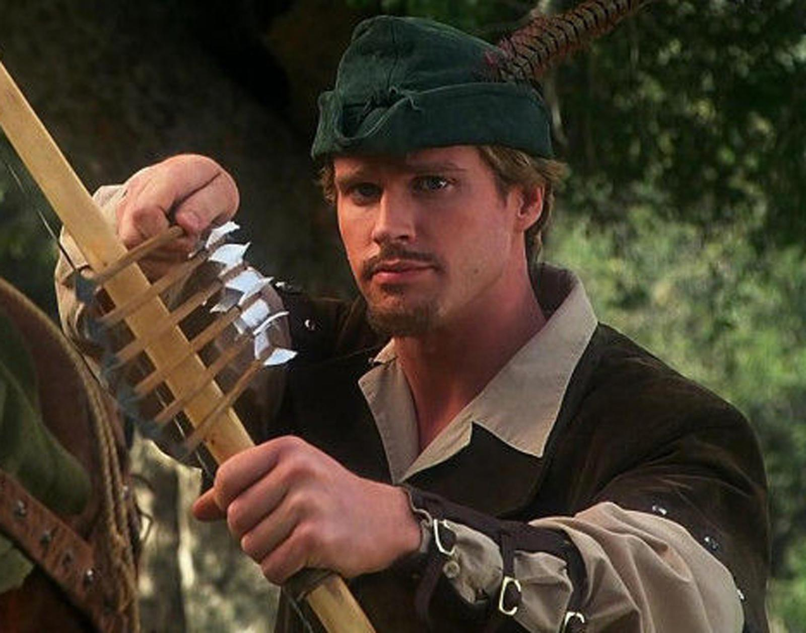 robin hood men in tights banner 10 Things You Never Knew About Cary Elwes
