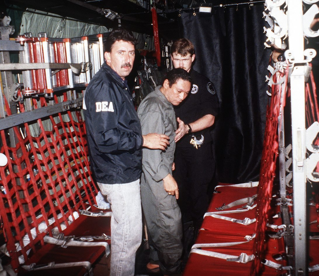 gen manuel noriega is escorted onto a us air force aircraft by agents from c06109 1600 e1616595636858 20 Things You Never Knew About AC/DC