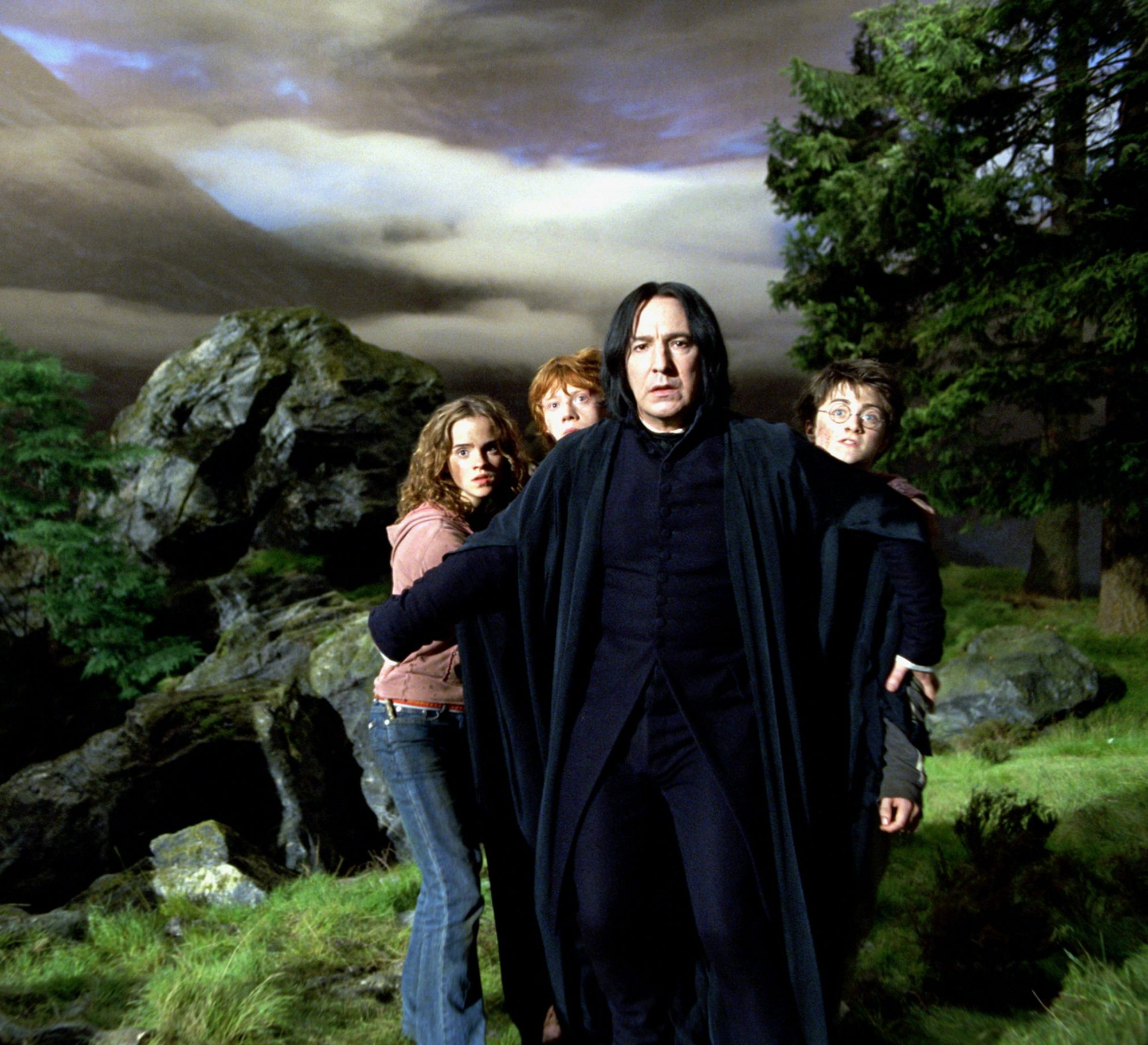 WB F3 SnapeStandsInFrontOfHarryRonAndHermione TRL 022C UP HPE3 scaled e1615387788414 20 Things You Might Not Have Realised About The Late Alan Rickman