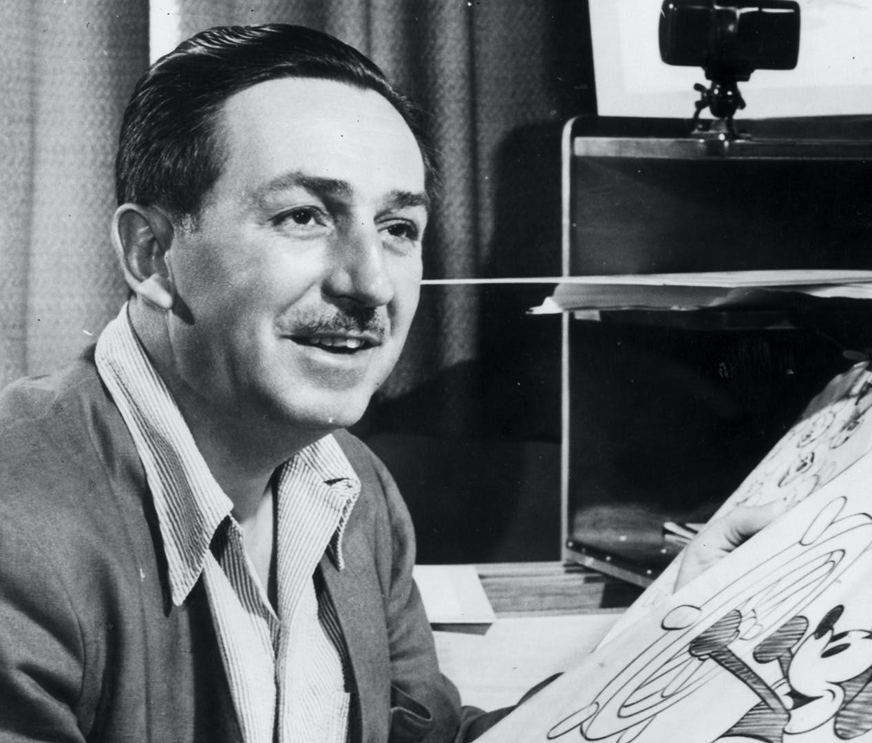 https www.biography.com .image MTYyMTYxNzU3NTAxMDA3NDg1 disney drawing mickey photo by hulton archive getty images e1608135498376 20 Magical Facts You Might Not Have Known About Walt Disney