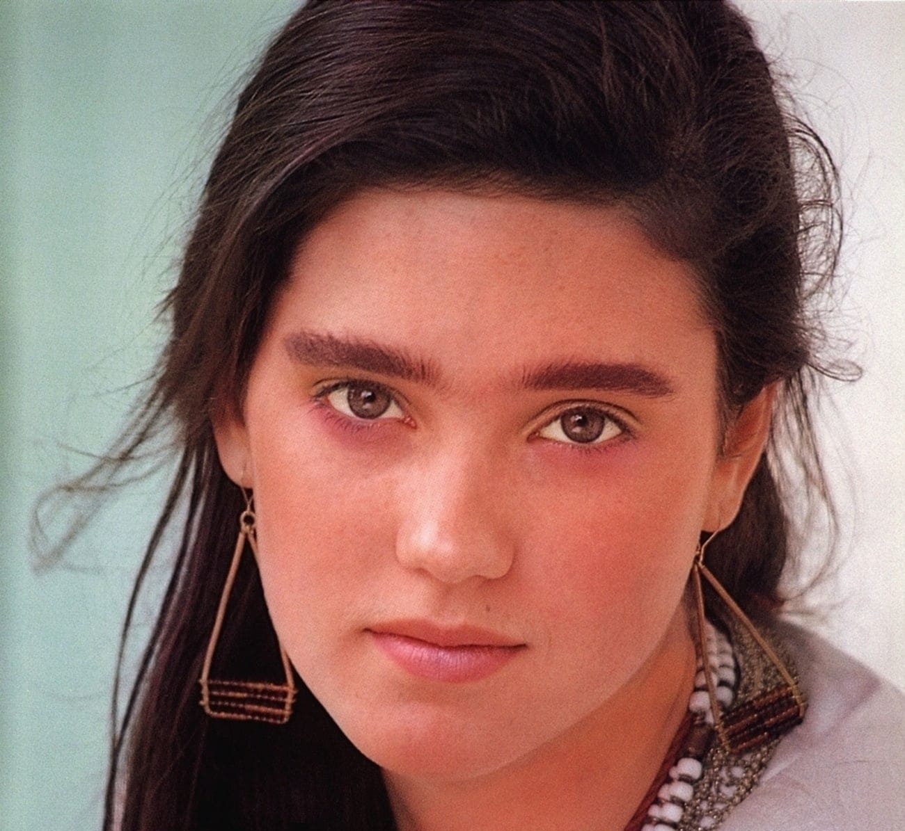 young jennifer connelly in white blouse and white beaded necklace photo u1 e1610012784200 20 Things You Probably Didn't Know About Jennifer Connelly