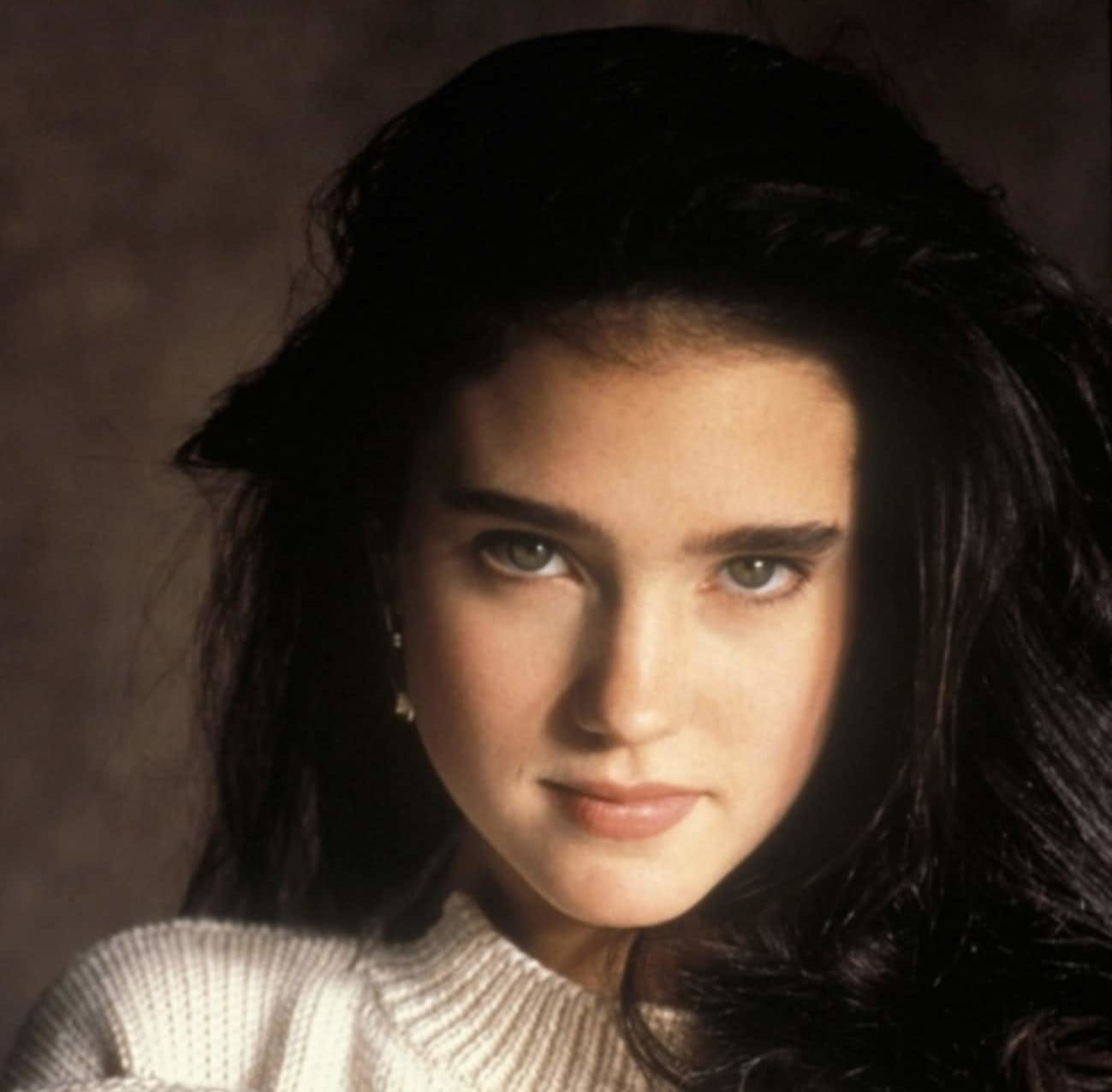 young jennifer connelly in white turtleneck sweater photo u1 e1610012899250 20 Things You Probably Didn't Know About Jennifer Connelly