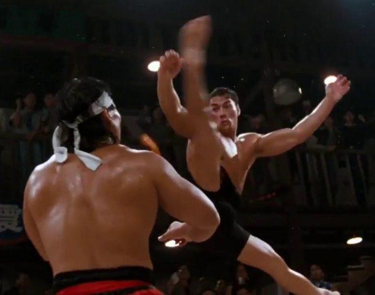 MV5BOTA3NTk3YWQtNjJjMS00M2Y4LWI1OTktMjRlMjJkZTU1NTQ1XkEyXkFqcGdeQXVyMjg0NjIyNDM@. V1 e1619086372288 25 Crotch-Punching Facts About Jean-Claude Van Damme's 1988 Film Bloodsport