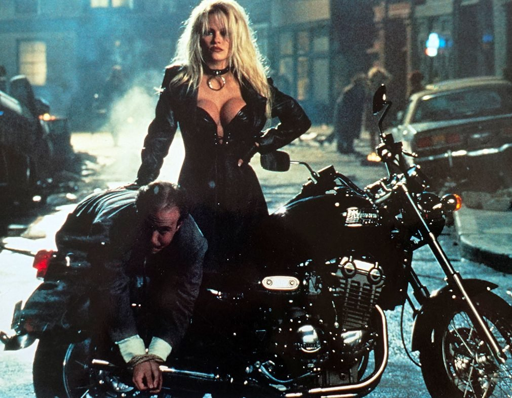 barb wire original lobby card 9x12 in 1996 david hogan pamela anderson e1615475043429 20 Celebrities Who Went Completely Broke