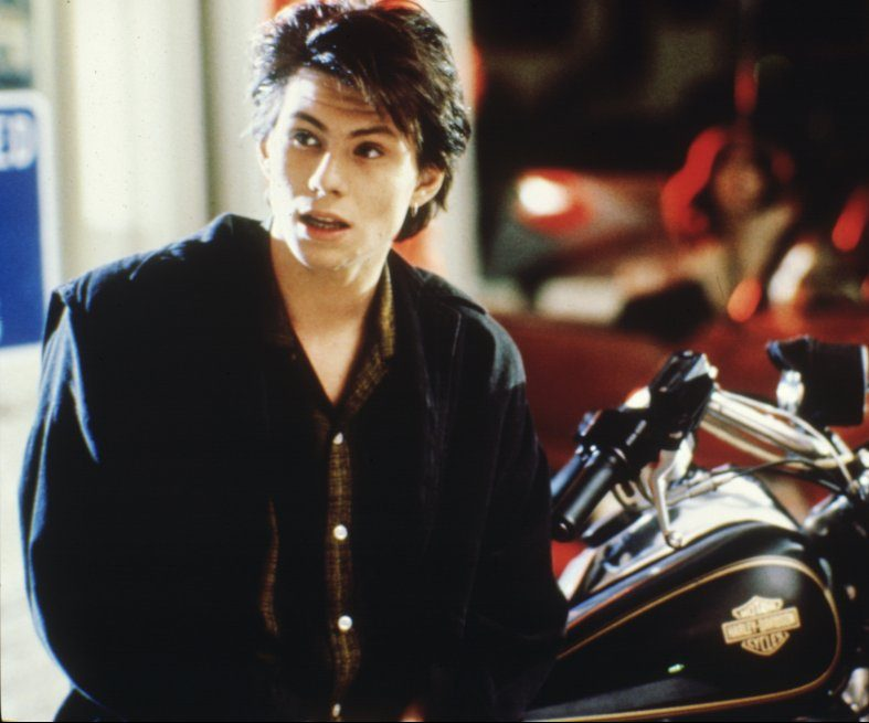 heathers 1988 004 christian slater motorbike 00m of9 0 e1619623123923 20 Things You Probably Didn't Know About Christian Slater