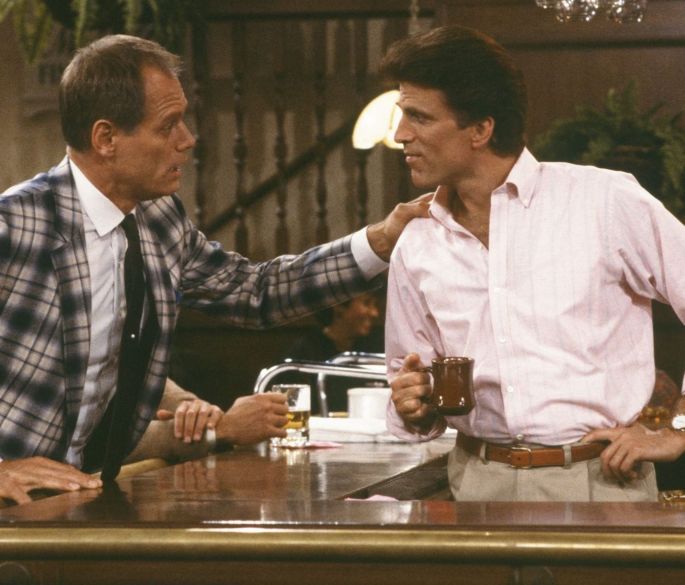 Ted Danson Fred Dryer Cheers e1623670099763 Raise Your Glasses To These Facts You Might Not Have Known About Cheers