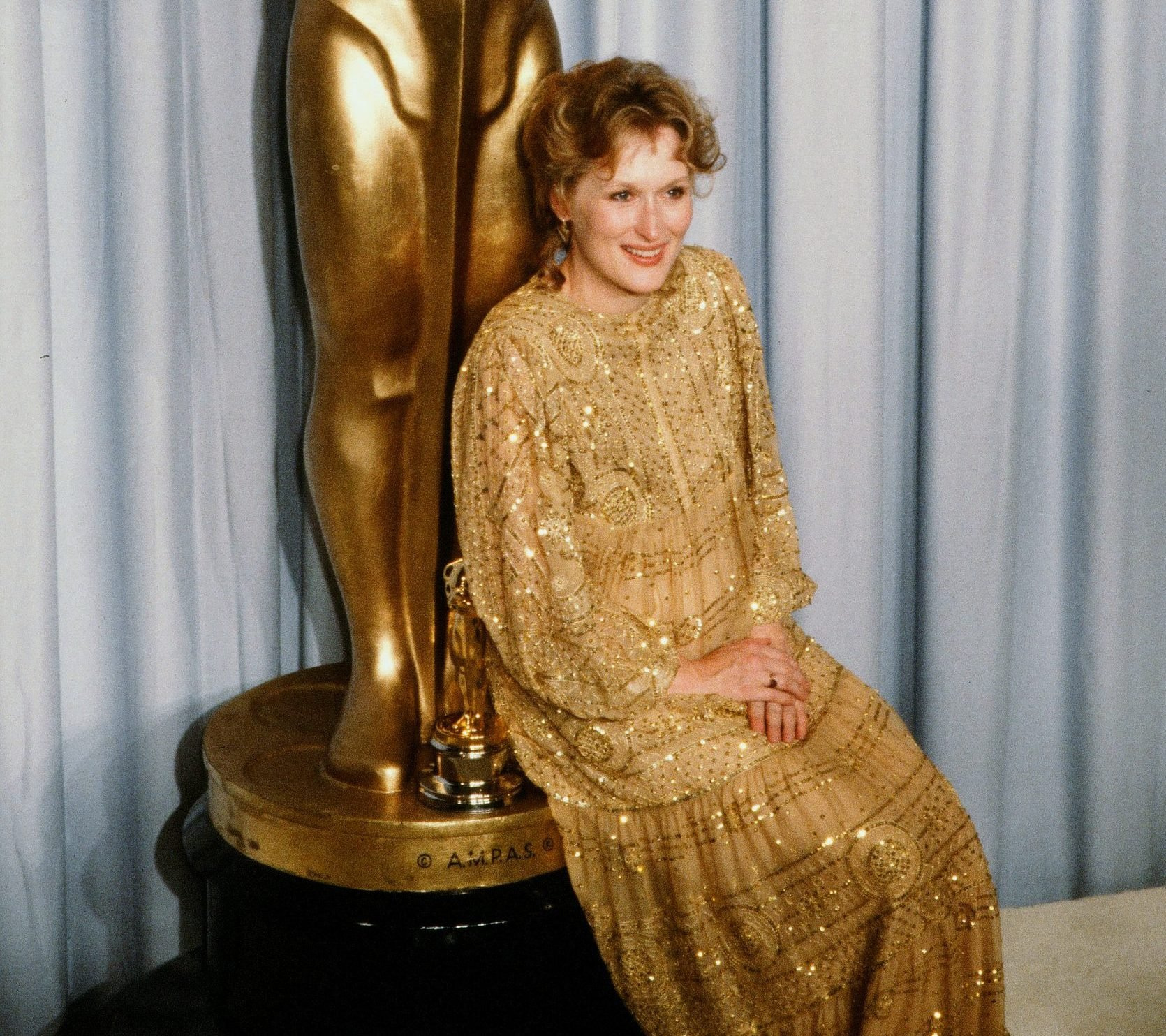 GettyImages 562777459 scaled e1627466676494 Most Bizarre Celebrity Red Carpet Looks From The 1980s