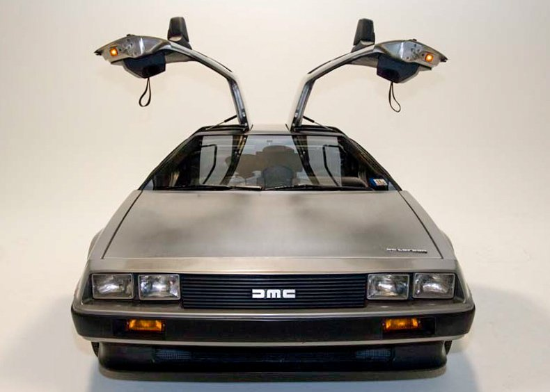 DeLorean DMC 12 with doors open DeLorean: The Strange Story Behind The Iconic 80s Sports Car And Its Creator